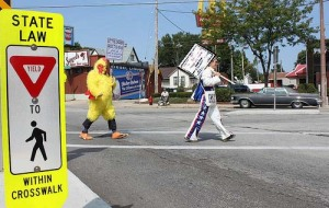 StreetShare Pedestrian Safety Week was an initiative I developed with the help of the Mayor's Bicycle and Pedestrian Task Force.  The Chicken suit and other costumes were all me though.